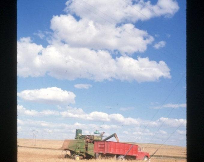 35 mm Ektachrome Slide: Green Harvester, Red Truck, Blue Sky, 1965 Vintage Photo Snapshot
