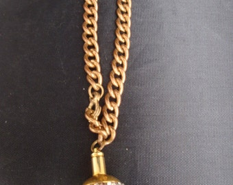 Interesting Brass and Rhinestone pill container with heavy link wrist chain