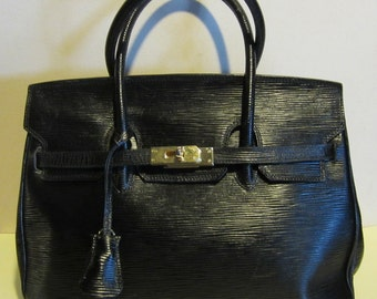 Vintage leather handbag.  black, with lock and key, vg condition, Italy.