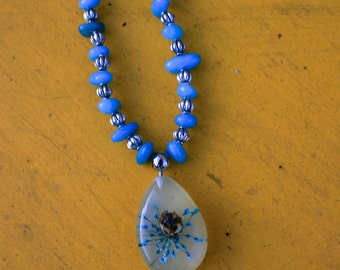 Resin Bug Pendant with Turquoise and Silver colored beads.