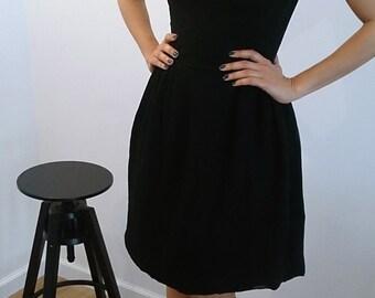 ILGWU ***Perfect little black dress***  3 layers skirt . slightly exposed back . size XS