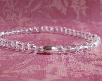 Dainty faceted Crystal Clear Quartz stretch bracelet with sterling silver tube bead