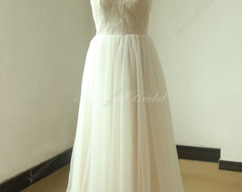 Roamantic flowy ivory lace a line beach, destination wedding dress with sweetheart neckline