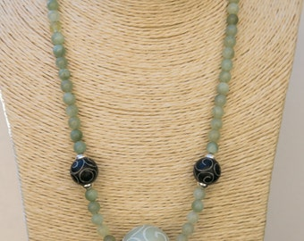 "Green and Black jade necklace with 6mm jade beads, 2 large carved black jade bead and a large carved green jade focal bead. 20"" in length"