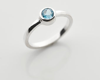 Small blue topaz and sterling silver ring