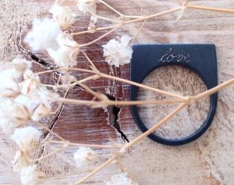 squared black silver ring