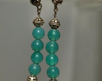 Polished cyan-turquoise green agate with Bali silver beads on fishhook wire with matching silver bead