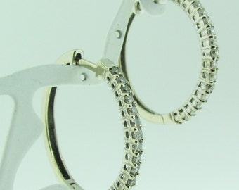 14 K white gold and diamond hoop earrings.