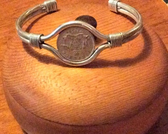 Bracelet, sterling silver wire and sixpence