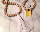 LEATHER TASSEL NECKLACE white leather tassel