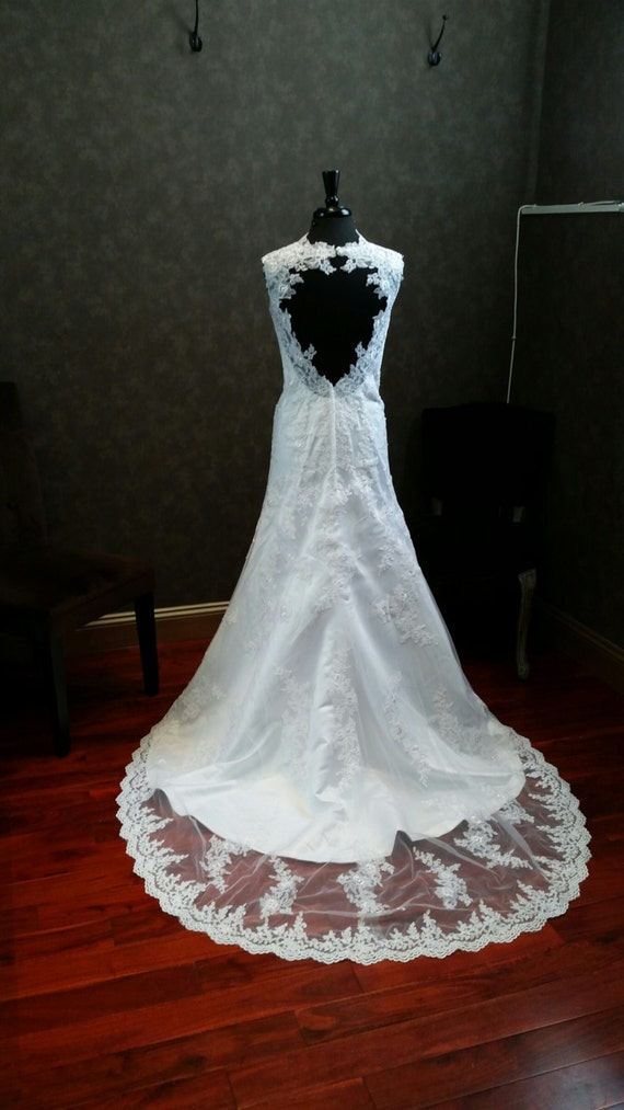Lace wedding dress with straps and open heart shaped back for Heart shaped wedding dress