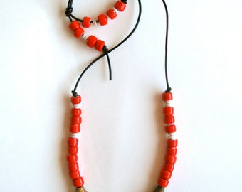 Long beaded necklace Native American coral and cream colored glass beads brass Ghanian beads on black leather cord