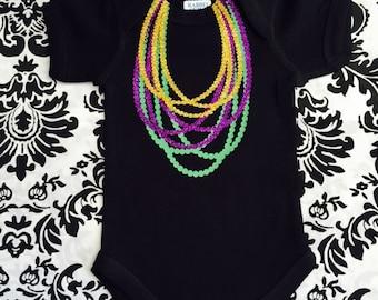 Mardi Gras baby, Mardi Gras onesie,Mardi Gras beaded onesie, onesie with Mardi Gras beads,trendy Mardi Gras onesie, glitter Mardi Gras beads