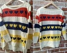 Women's Vintage/Retro Oversized Boyfriend Sweater, Hi-lo Hem and Three Quarter Sleeves with Heart Pattern in Cream, Red, Navy & Yellow.