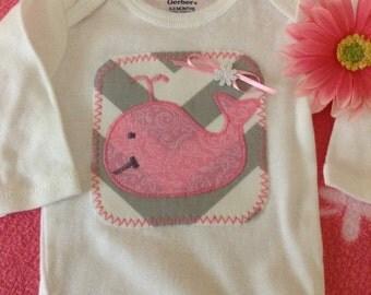 Baby girl's whale appliqué onesie