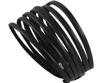 Black handmade leather bracelet made of narrow strips of leather
