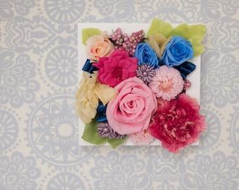 Preserved /  Pink flower arrangement in a frame