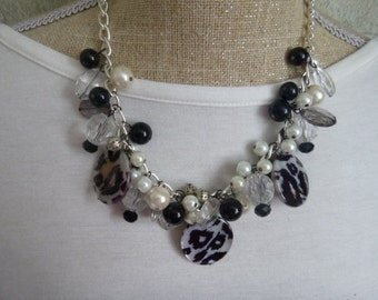 black / white shell and mother of pearl charm necklace.