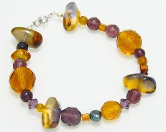 A handmade purple and orange beaded bracelet