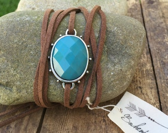 Brown suede cord with turquoise colored stone and silver connector