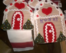 crochet gingerbread house towel holder and hotpads. gingerbread men hotpads/potholders