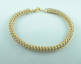 14K White and Yellow Gold Bracelet.