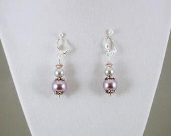 Dangle pearls and crystal earrings