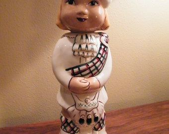 "Charming Vintage Scottish Lass Decanter, labeled ""Motney"""