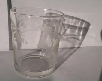 Glass tea light with a hand etched art nouveau flower