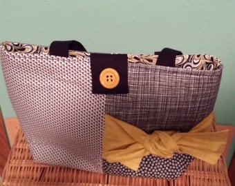 Black, White, and Gold bag with Velcro Closure