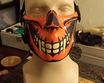 Leather Skull Motorcycle Half Mask. Custom made Hand tooled leather with your choice of colors.