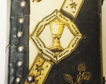 "Hungarian book, leather and bone bound. 7 1/2"" x 5 1/2"" x 3 1/2"". Printed in Budapest, 1906"