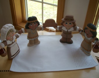Ceramic Hand holding thanksgiving pilgrims and indians