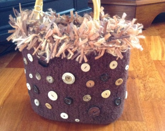 A pure wool felted handbag trimmed with co-ordinations buttons