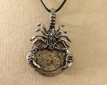 Steampunk necklace with watch movement