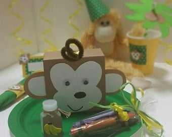 Monkey Party Favors filled favor boxes with crayons and bubbles