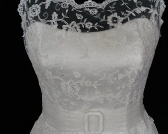 1950's style tea length wedding dress. Lace bodice with open back detail and full circle skirt, which has full petticoat and hoop attached.
