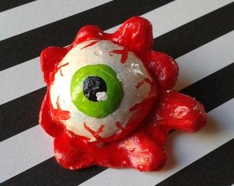 Green eyeball pin