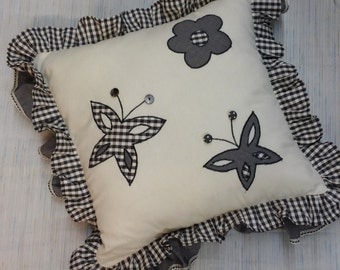 Pillow with flower and butterflies