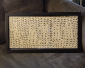 Exterminate! Doctor Who framed filet crochet featuring The Doctor and Daleks.