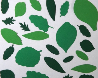 25 - 100 Leaf cutouts for card making and scrapbook in. Various sizes, shapes and shades of green. Free postage.