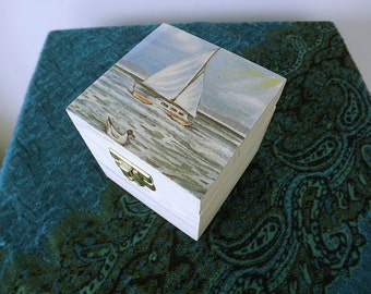 Handmade, cubic box with sailboat.