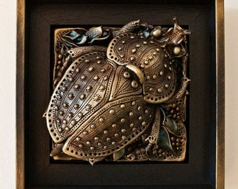 Beetle relief with a frame