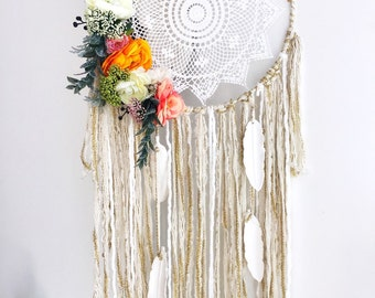 """Dreamcatcher / dream catcher 12 """" diameter. Peonies and ranunculus cascade down one side. Hanging White feathers"""
