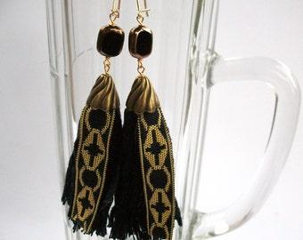 Smaller fabric tassel earrings black gold cross monastery framed glass bead, with ear clip available