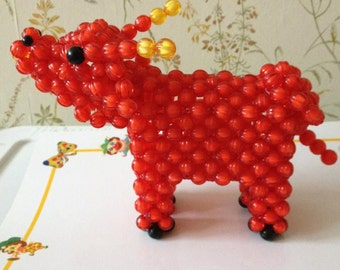 beaded red cow
