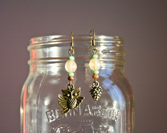 Asymmetric earrings, OWL and pinecone.