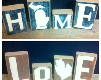 Michigan themed blocks. Blocks are made from 2x4s and painted and sanded. They have a smooth surface and are durable.
