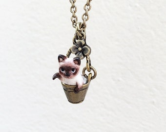Tiny Siamese Cat in the bucket necklace, Cat Pendant, polymer clay, hand sculpted, hand painted with Acrylic colors.