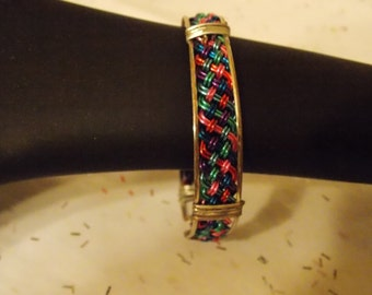 Turquoise, purple, pink, and blue silver plated wire braided bracelet